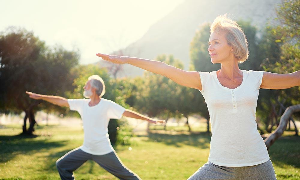 Retired couple doing yoga